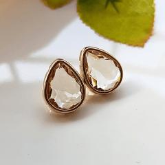 Brinco gota de cristal honey com bordas douradas