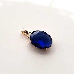 Pingente oval de cristal azul safira 16x12mm