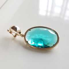 Pingente oval de cristal verde turmalina 25x18mm